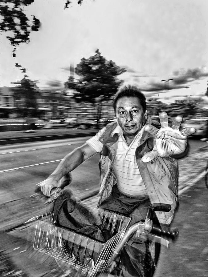 Street Photograph - Unknown Bicycle Rider by Daniel Gomez
