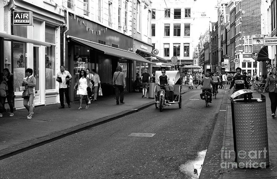 Bike Photograph - Street Riding In Amsterdam Mono by John Rizzuto