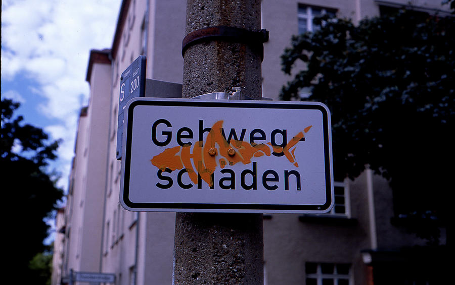 Street Sign Photograph - Street sign with graffiti by Nacho Vega