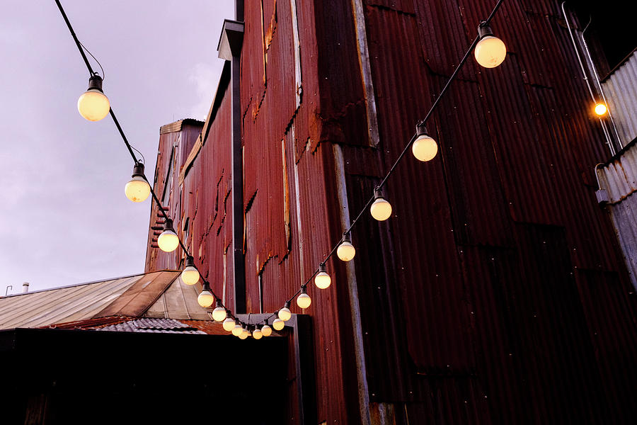 String Of Lights Near An Old Brown Building In Saint Augustine F by John McLenaghan