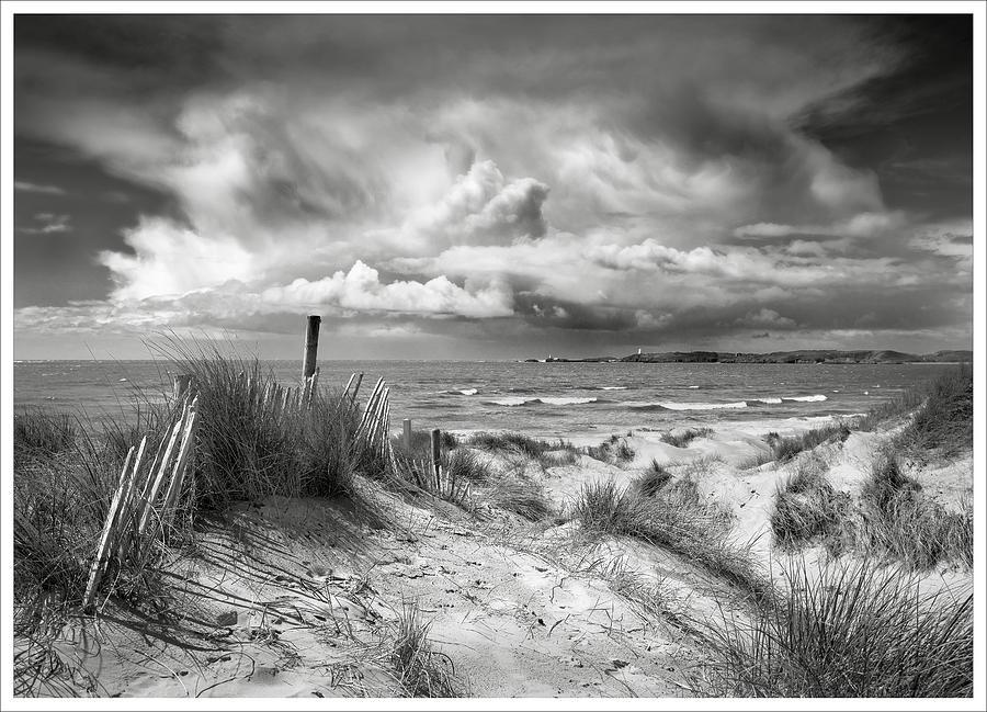 Summer storm over Ynys Llanddwyn by Richard Greswell
