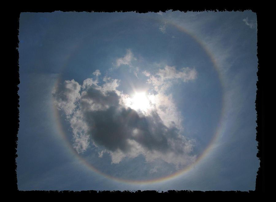 Sun Photograph - Sun Portal  A Rainbow Around The Sun With Black Border by Adam Long