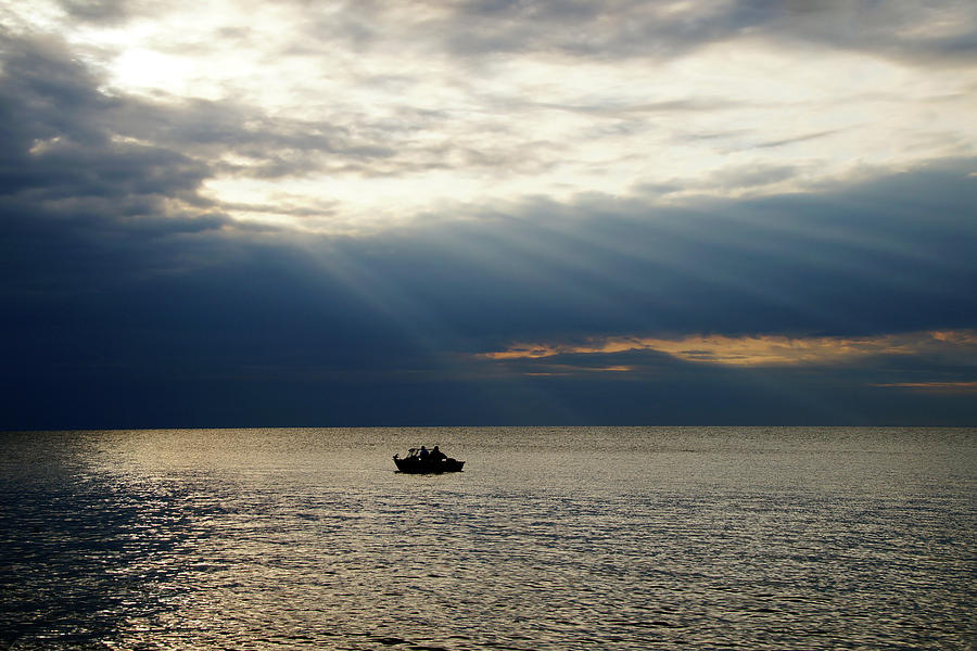 Fishermen Photograph - Sun Rays over Fishermen by Mike Murdock