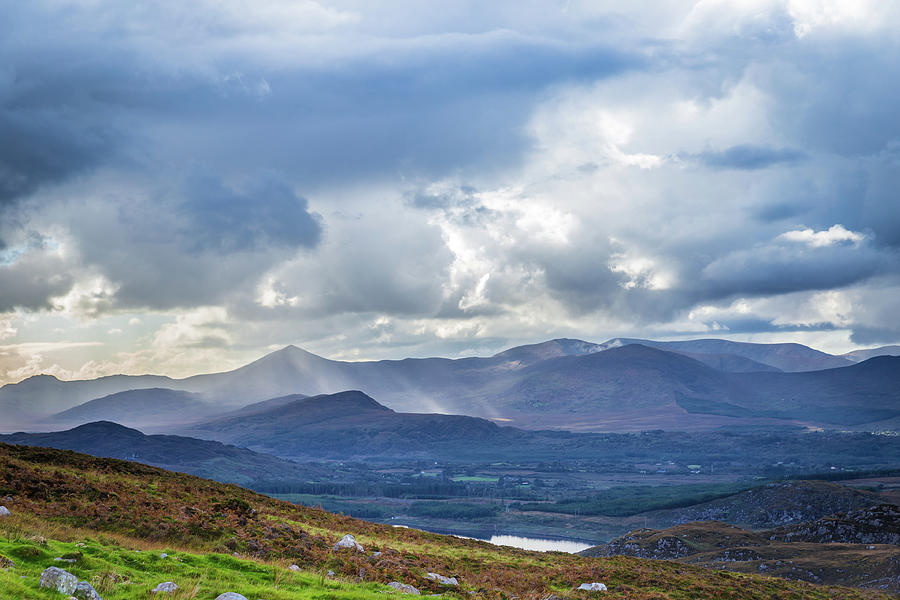 Sun rays piercing through the clouds touching the Irish landscap by Semmick Photo