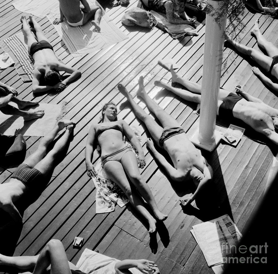 Sunbather Photograph - Sun Tanning At The Deligny Swimming Pool, Paris, June, 1963 by French School