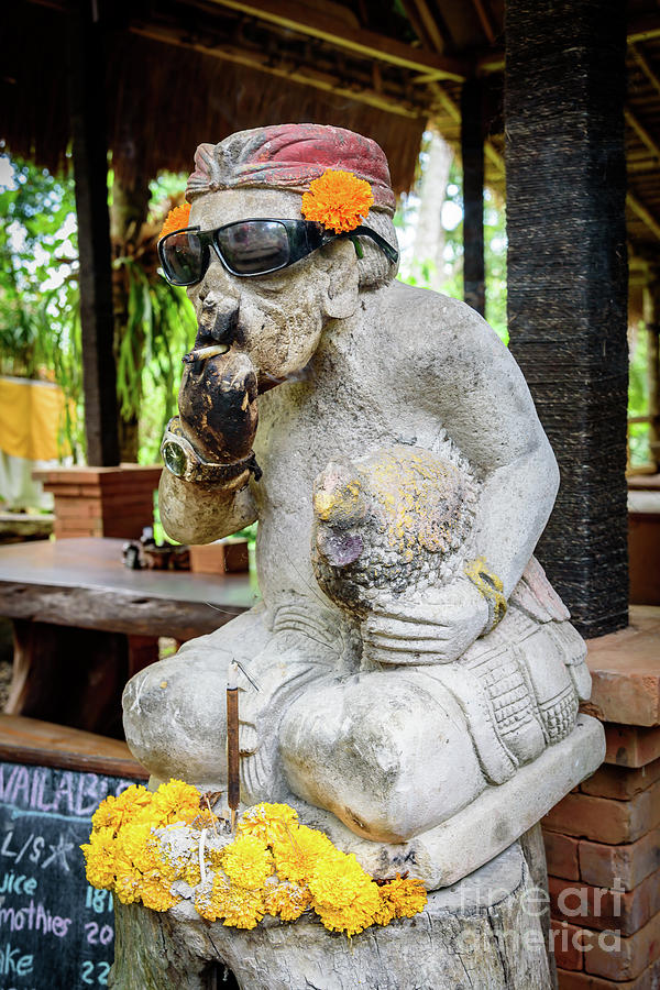 Sunglass wearing smoking statue on Campuhan Ridge Walk in Ubud, Bali by Global Light Photography - Nicole Leffer