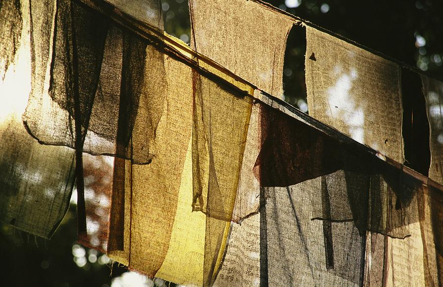 Asia Photograph - Sunlight Filters Through Prayer Flags by Michael Melford