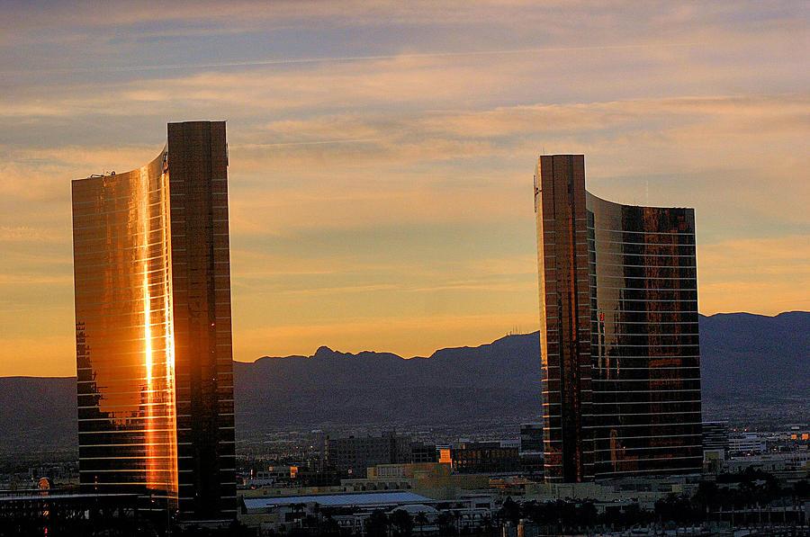 Scenic Photograph - Sunrise In Las Vegas by Bill Mollet