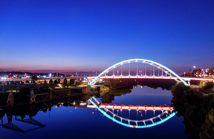 Sunrise over the Gateway Boulevard bridge Korean War Veterans Memorial Bridge in Nashville, TN by Tom Blizzard
