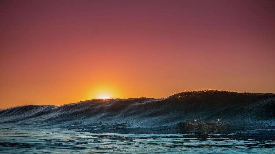 Wave Photograph - Sunrise Peeking by Joseph McGrew
