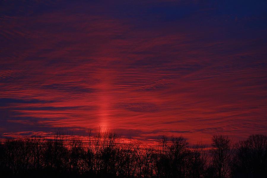 Sunrise pillar of light by Donna Quante