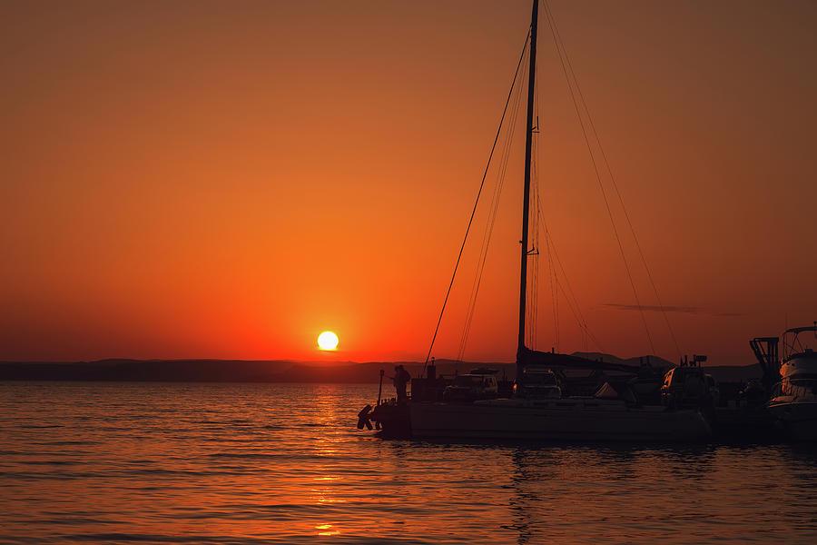 Setting Sun Photograph - Sunset And Silhouette by Mariia Kalinichenko