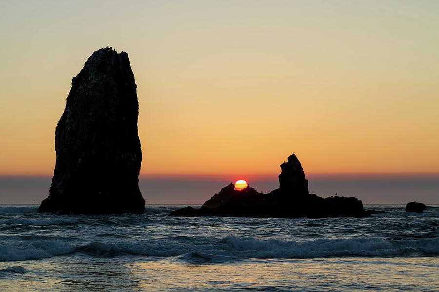 Sunset Photograph - Sunset at Cannon Beach by David Gn