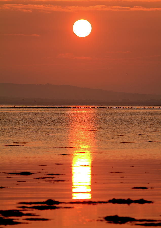 Sunset Lindisfarne by Ian Sanders