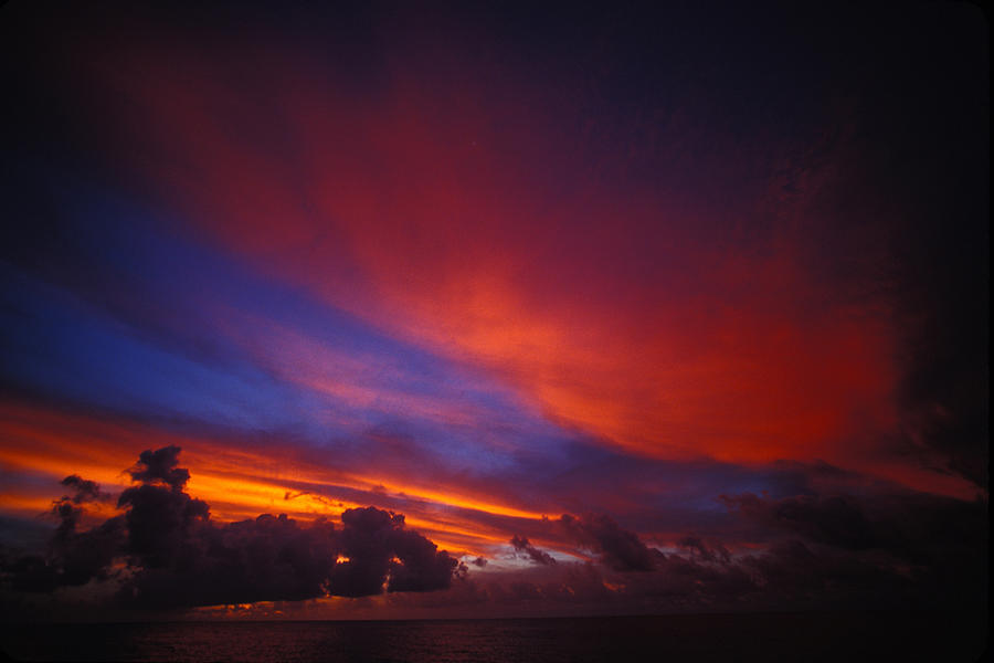 Color Image Photograph - Sunset Over The Ocean by Nick Norman
