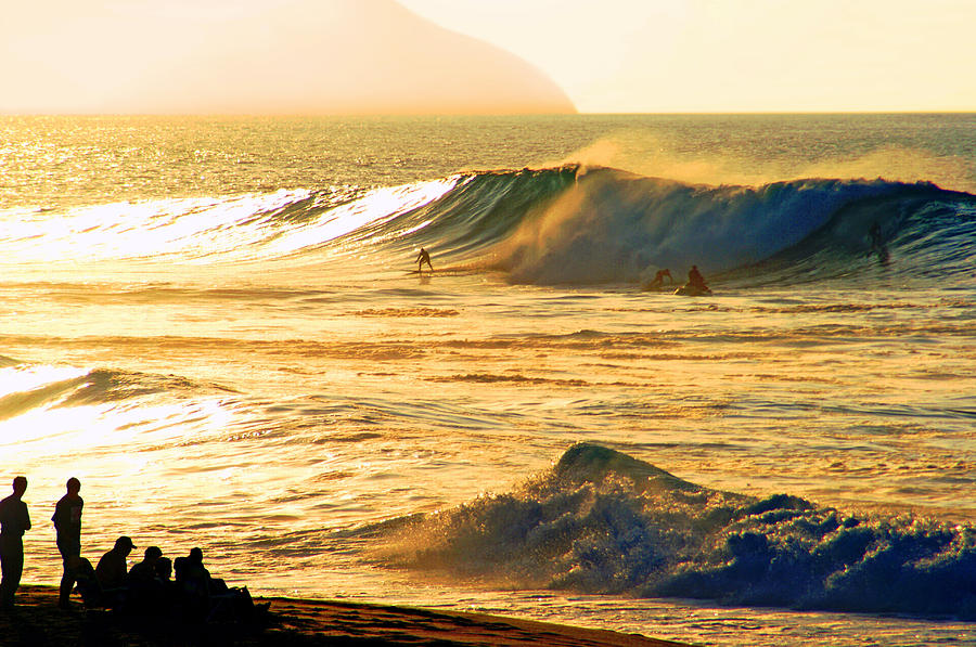Rock Piles Photograph - Sunset Surfers by Kevin Smith