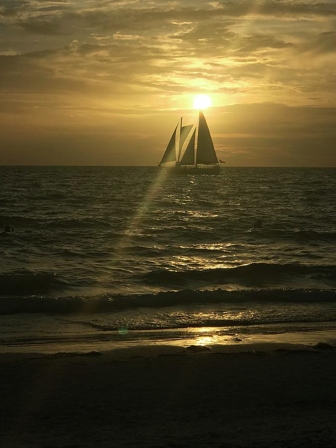 Sunset Through Sailboat Photograph by John Hampton