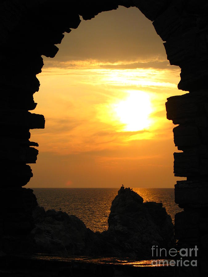 Sunset With Stone Frame Photograph By Jeff White