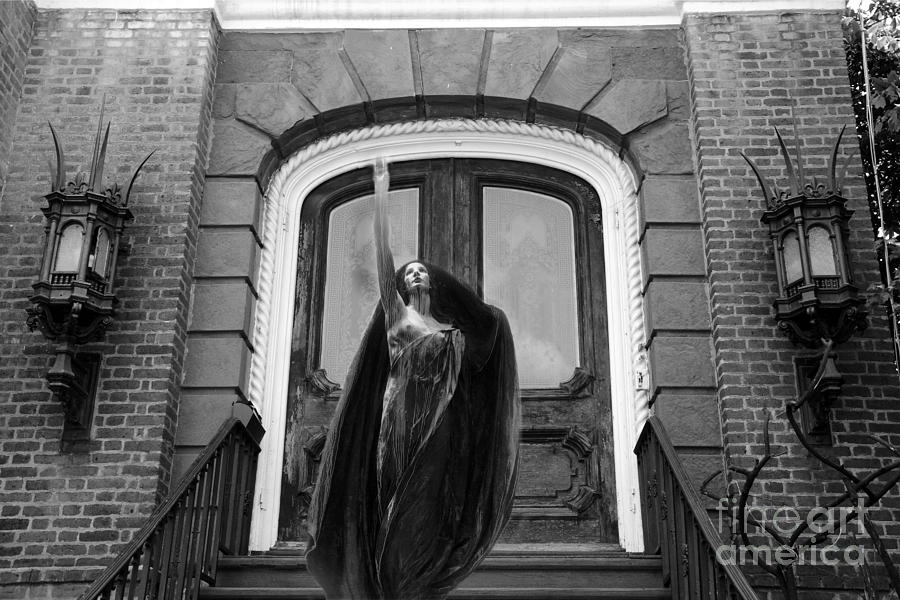 Surreal gothic black and white female figure black cape haunting spooky surreal black white art photograph
