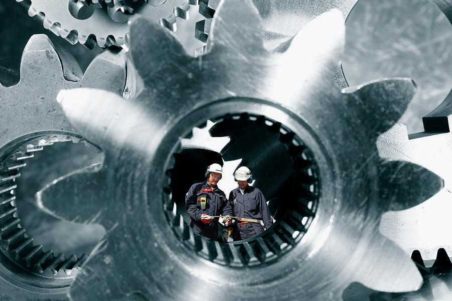 Surreal Image Of Workers Inside Giant Gears And Cogs Photograph
