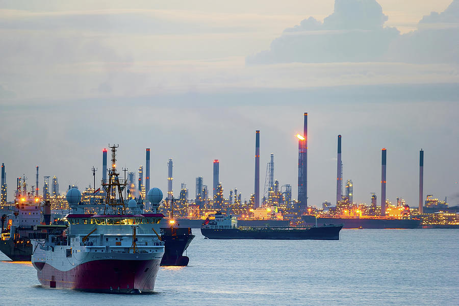 Singapore Photograph - Survey And Cargo Ships Off The Coast Of Singapore Petroleum Refi by David Gn