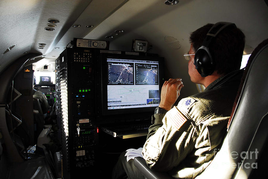 Cockpit Photograph - System Operator Operates A Console by Stocktrek Images