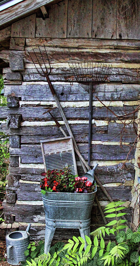 Creative Photograph - Tall Log Cabin And Garden Tools by Linda Phelps