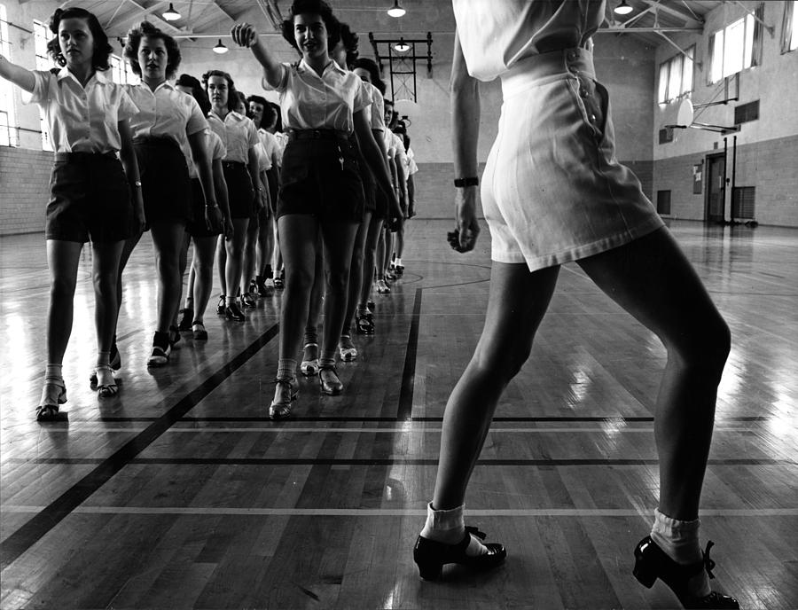 1940s Photograph - Tap Dancing Class In The Gymnasium by Everett