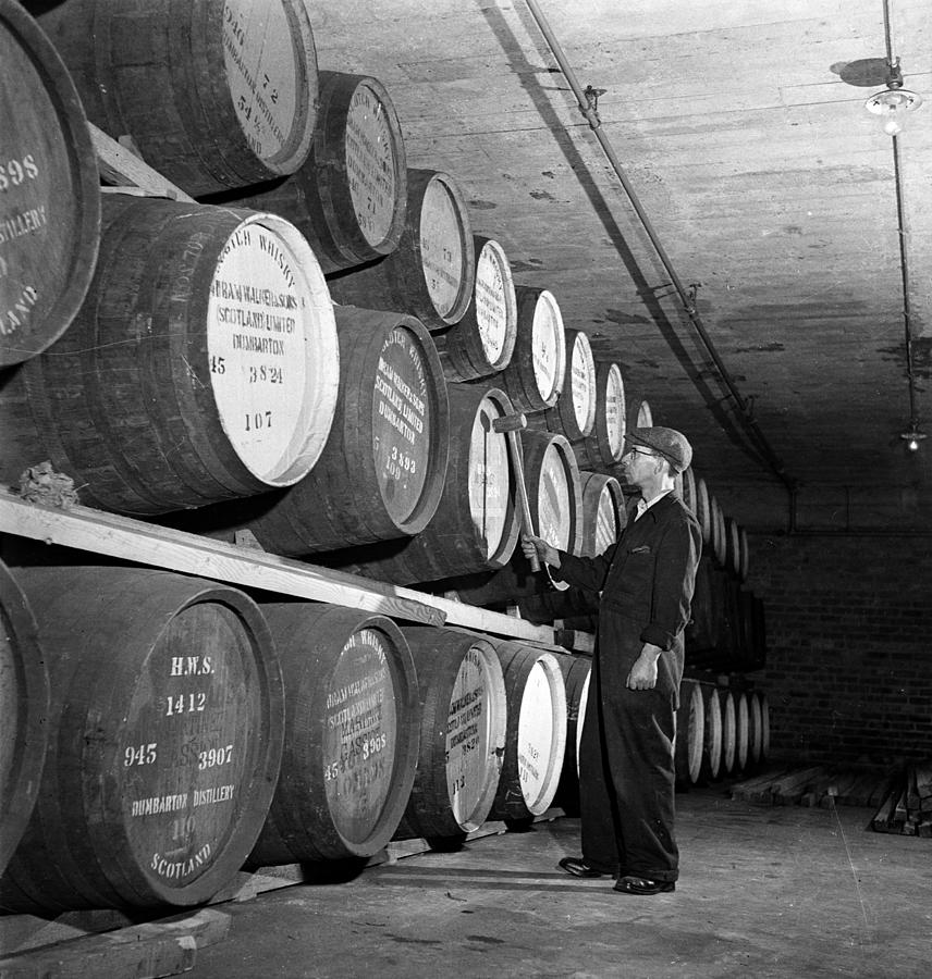 Mature Adult Photograph - Tapping Casks by George Konig