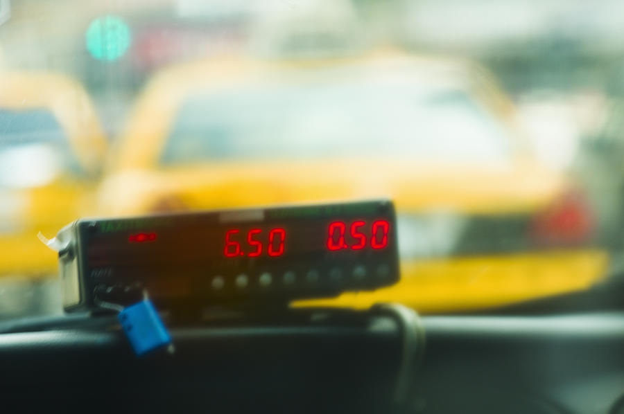 Taxi Meter Photograph by Tetra Images