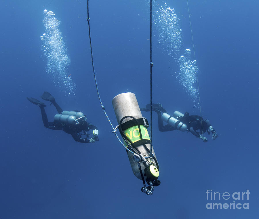 Diver Photograph - Technical Divers Ascend Near A Nitrox by Karen Doody