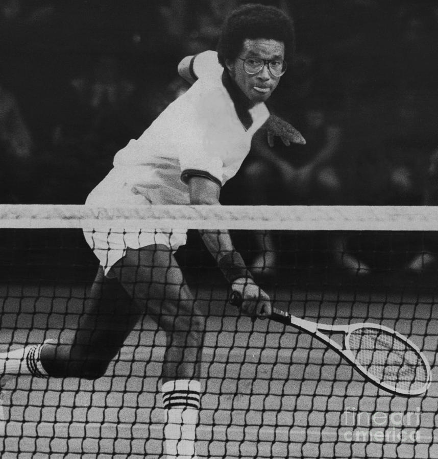Tennis Great, Arthur Ashe, Returns The Ball At The Atp Worls Tour Finals In 1979. Photograph by Bob Olen