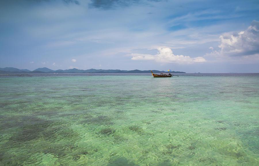 Horizontal Photograph - Thai Nok, Thailand by Photo by Jim Boud