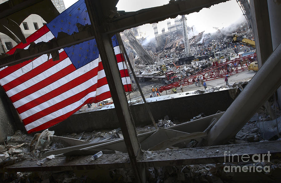 Firefighter Photograph - The American Flag Is Prominent Amongst by Stocktrek Images