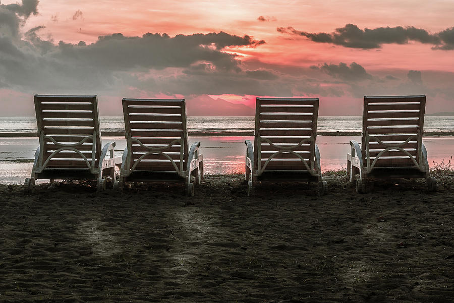 The Backside Of Four Chairs Close To The Beach In The Tropical S