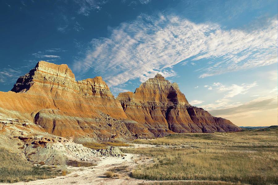 Badlands Photograph - The Badlands of South Dakota by Tom Mc Nemar