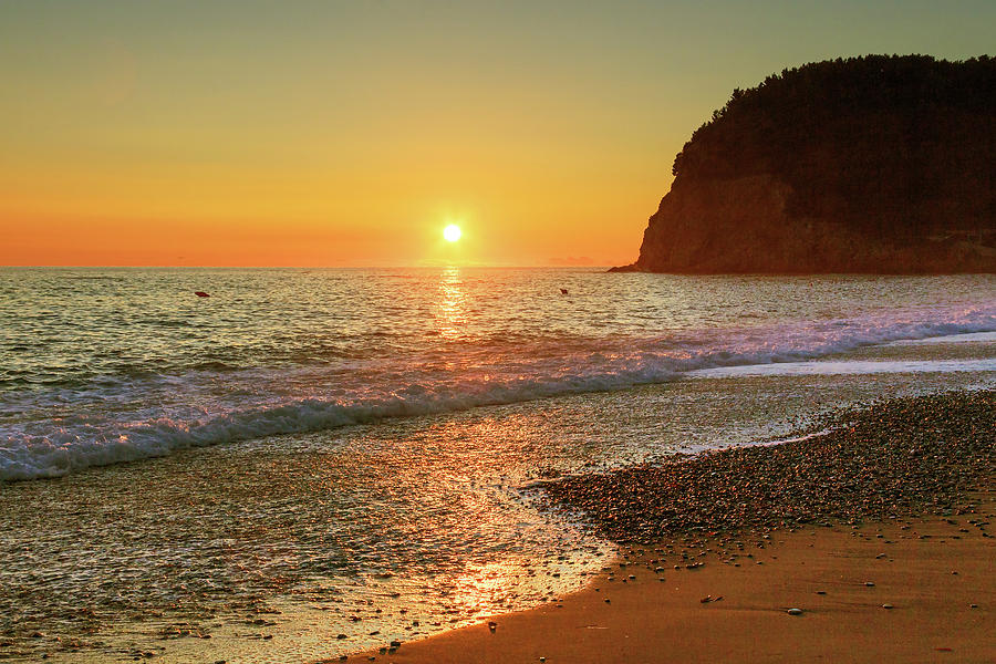 Sea Photograph - the beach and the Mediterranean sea in Montenegro in the summer at sunset by George Westermak