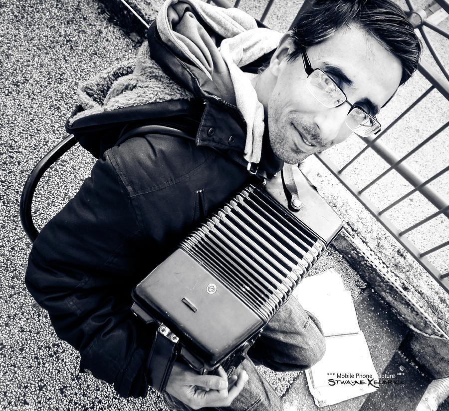 Portrait Photograph - The Brave Accordion Player by Stwayne Keubrick
