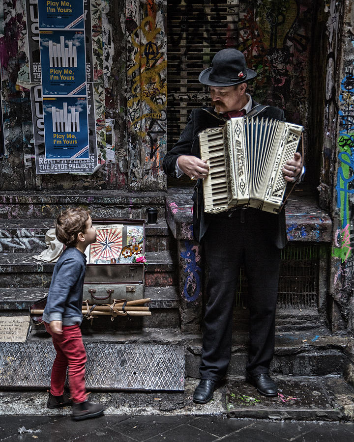 Busker Photograph - The Busker And The Boy by Vince Russell