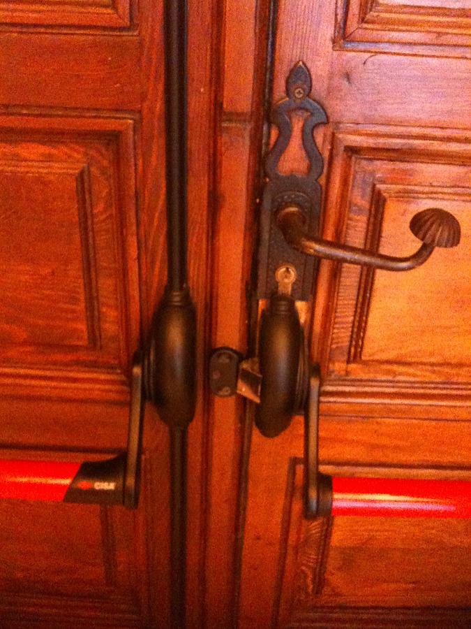 Door Photograph - The Doorknobs by Sara Efazat