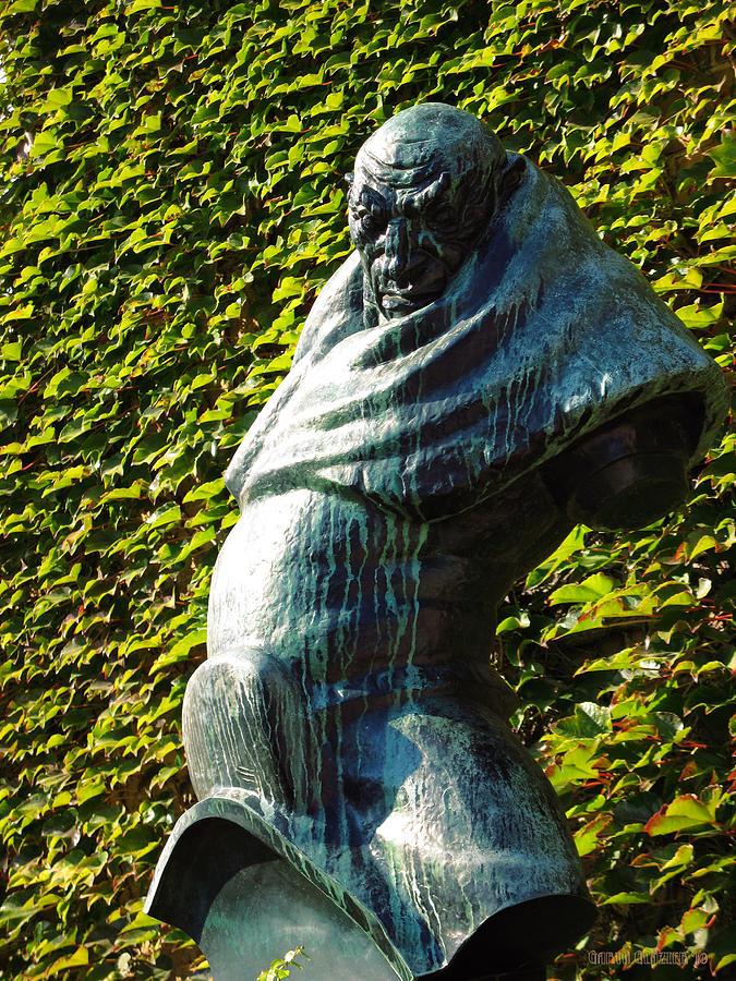 Sculpture Photograph - The Guardian Of The Garden by Garth Glazier