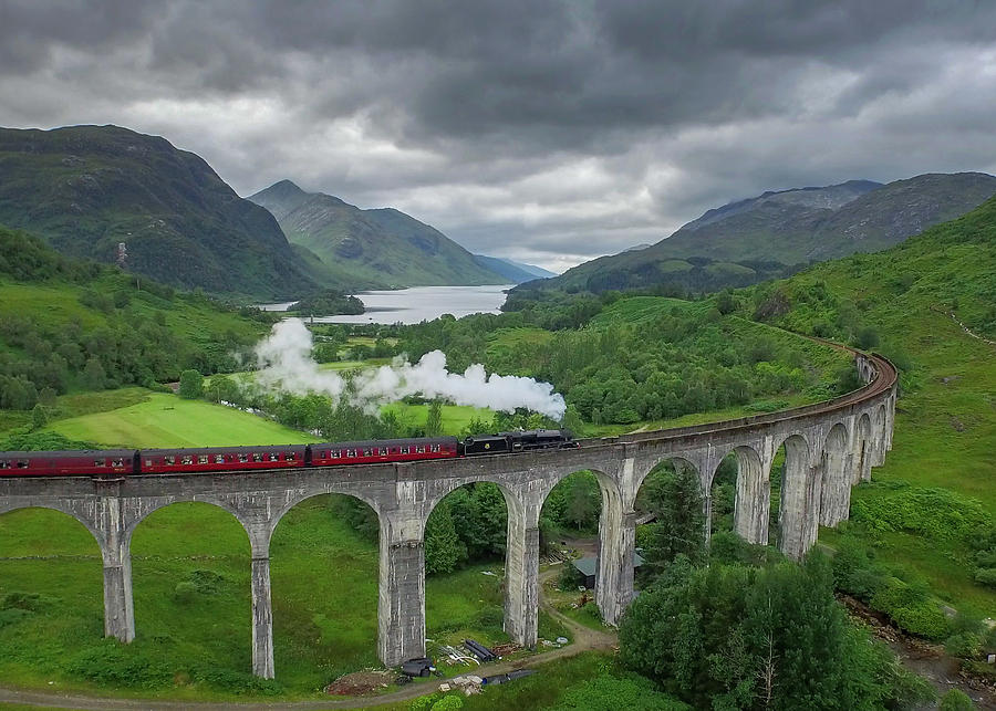 Glenfinnan Photograph - The Hogwarts Express at Glenfinnan by Liam Anderstrem