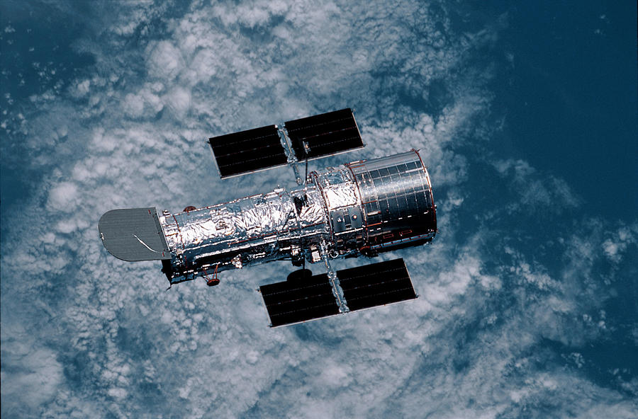 Earth Photograph - The Hubble Space Telescope by Nasa