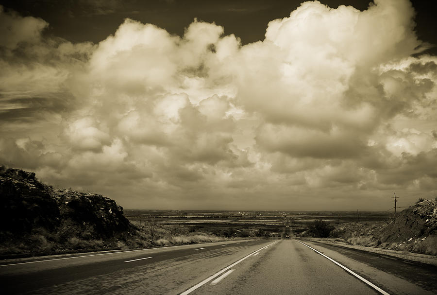 Clouds Photograph - The Road to Roswell by Claudia Botterweg