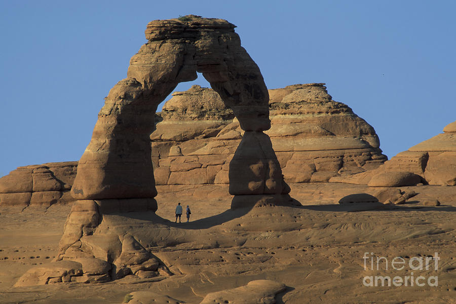 Utah Photograph - The Scale Of Delicate Arch by Stan and Anne Foster