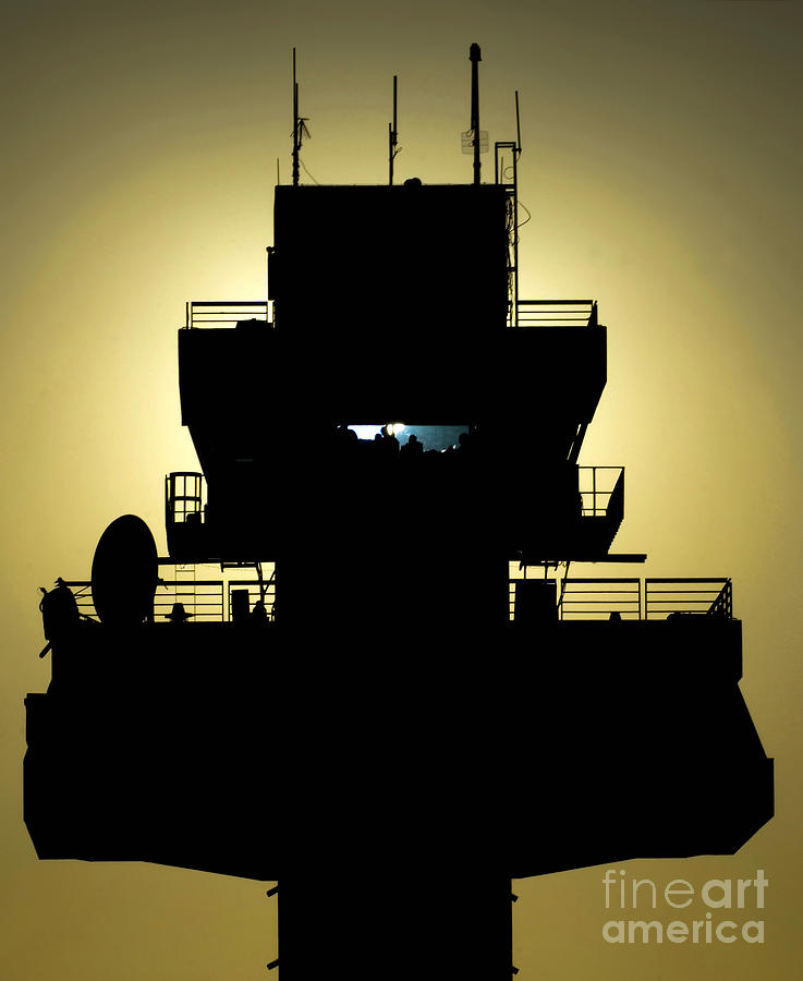 Military Photograph - The Setting Sun Silhouettes An Air by Stocktrek Images