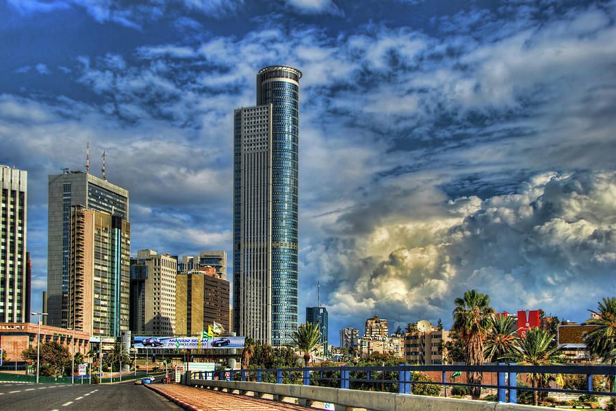Israel Photograph - The Skyscraper And Low Clouds Dance by Ron Shoshani
