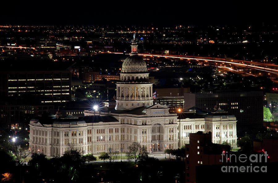 The Texas State Capitol At Night As Rush Hour Traffic Lights Streak Along  Interstate I-35 by Herronstock Prints