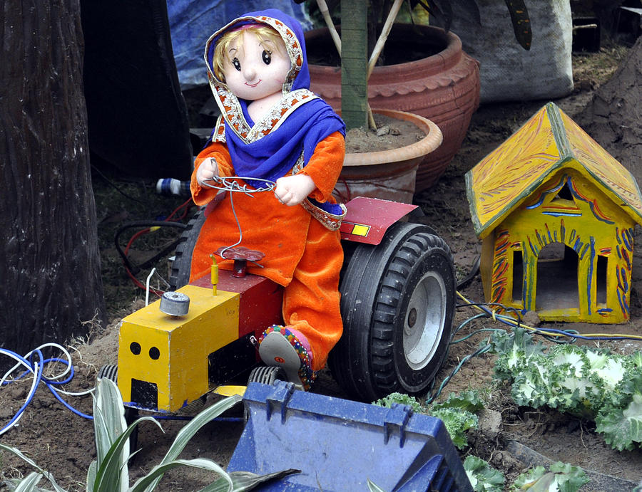 Toy Photograph - The Tractor Driver by Bliss Of Art