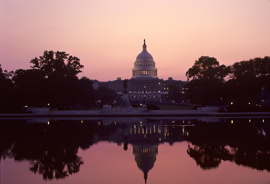 Capitol Building Photograph - The U.s. Capitol Building Reflected by Kenneth Garrett